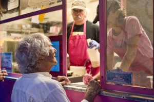 Bernie order a crepe from the crepe truck at Erin and Grace's wedding.
